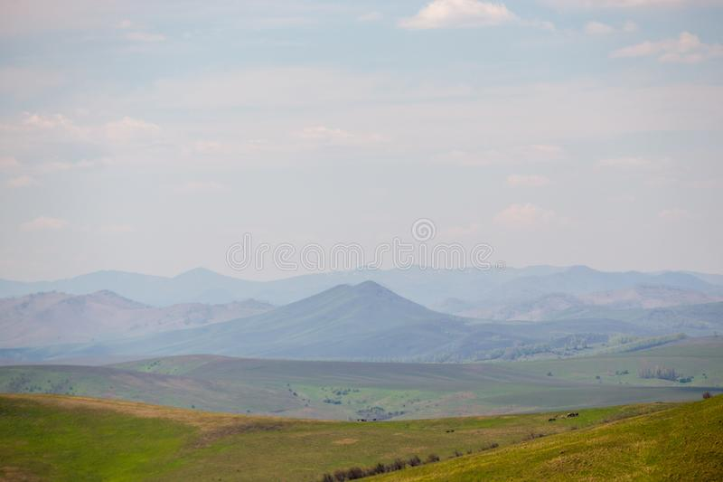 Altai mountain range on the horizon in colors, as in the paintings of Roerich royalty free stock images