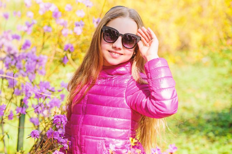 Spring holiday. Womens day. happy child with cherry bloom. summer nature. Sakura. Natural beauty. Childhood happiness royalty free stock images