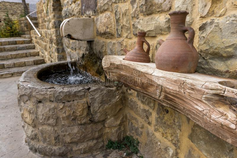 Spring holy water at an ancient church in Lebanon. Spring holy water at an ancient Christian church in Lebanon royalty free stock photos