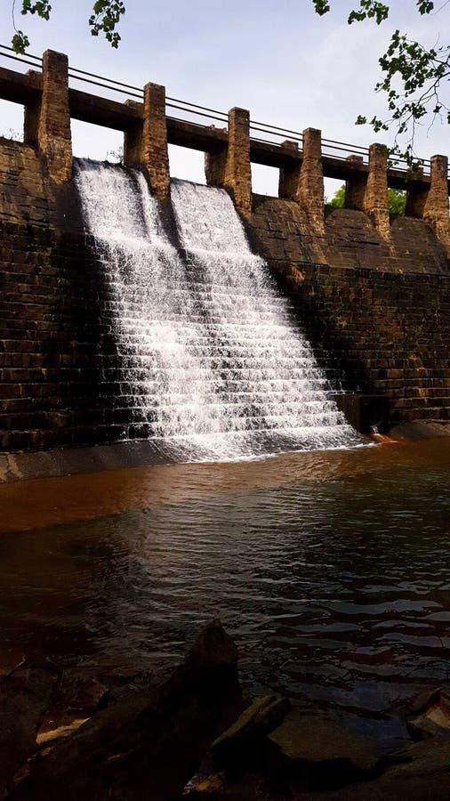 Spring lake spillway stock photo