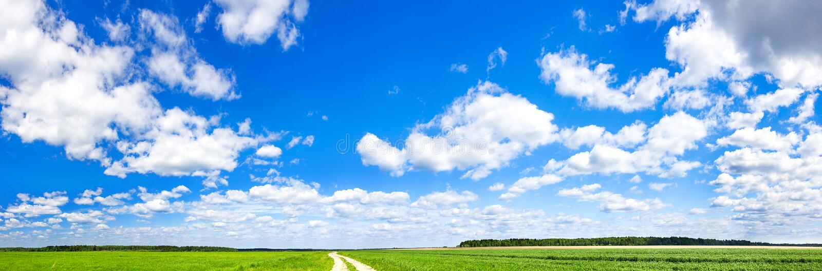 Spring landscape with blue sky,white clouds and field stock photos
