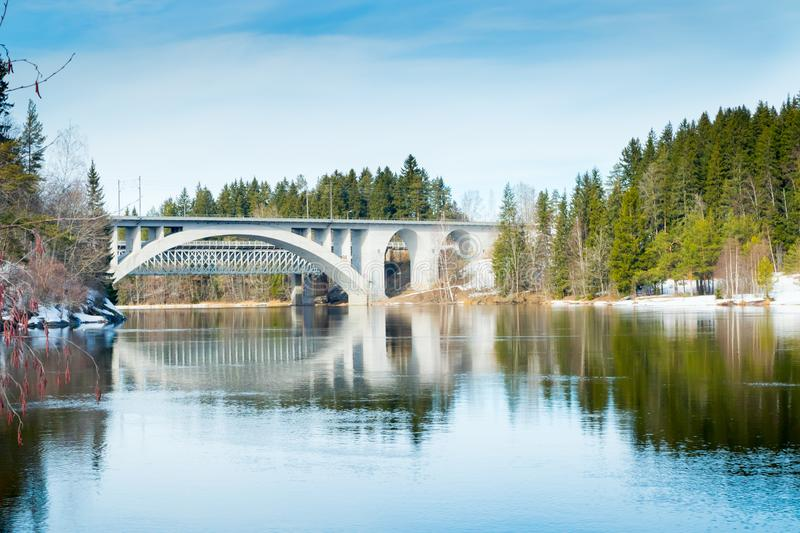 Spring landscape of bridge and Kymijoki river waters in Finland, Kymenlaakso, Kouvola, Koria.  stock photo