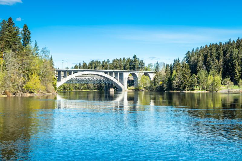 Spring landscape of bridge and Kymijoki river waters in Finland, Kymenlaakso, Kouvola, Koria.  stock photography
