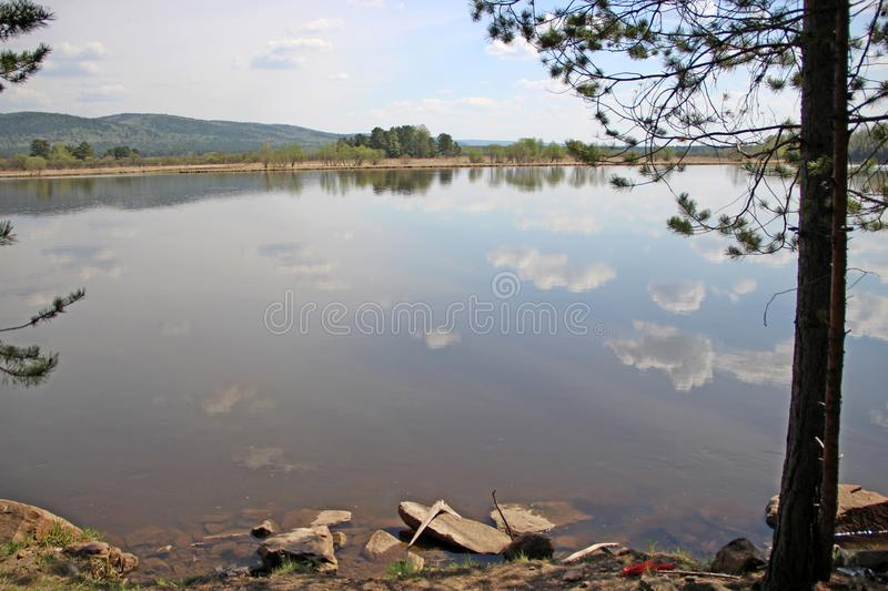 Spring landscape of the cloud pieces reflection in river royalty free stock photos