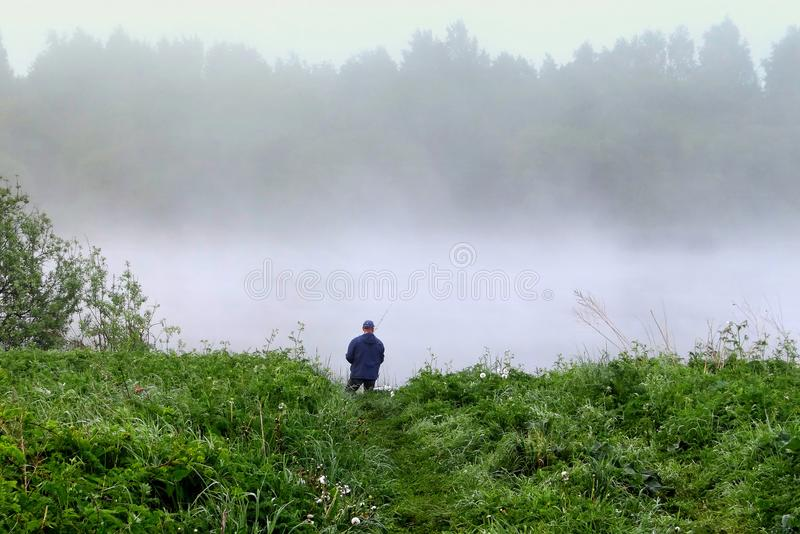 Spring landscape . Lonely fisherman. royalty free stock image