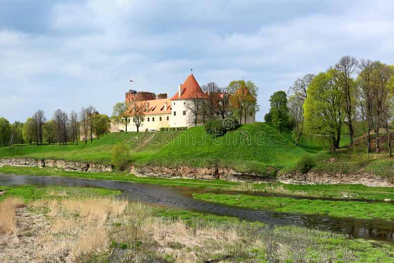 Spring landscape with old castle, Bauska - Latvia stock photography
