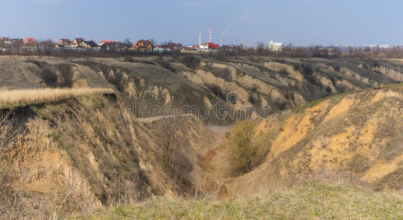 Spring landscape with soil erosion in outskirts of Dnepr city, Ukraine stock images