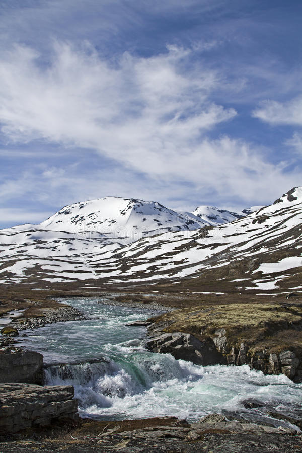 Spring in Leirdalen. The rivers and streams exempt slowly from ice and snow stock image