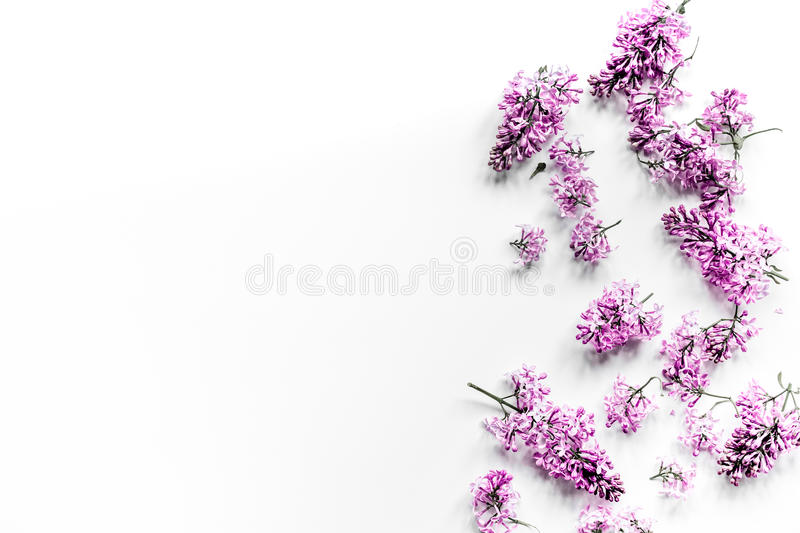 Spring lilac flowers on workdesk female home office white background top view mockup royalty free stock image