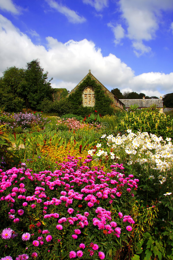 Spring magic garden with flowers and house, Lanhyd stock images