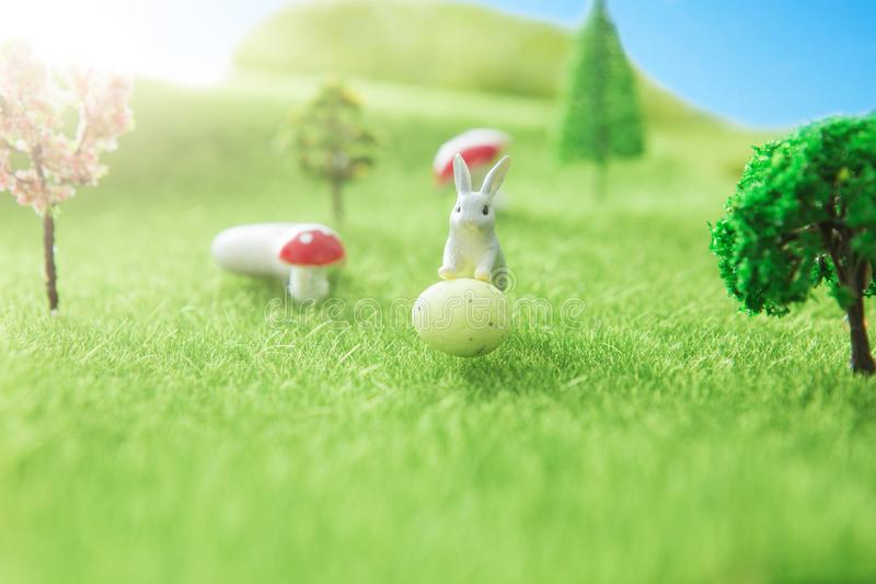 Spring meadow with rabbit and easter egg. Fairy tale royalty free stock photography
