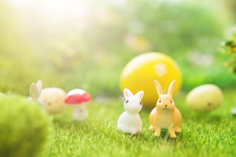Spring meadow with two white rabbit and easter eggs. Fairy tale stock images