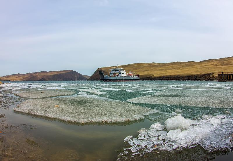 Spring melting ice of Lake Baikal, ferry crossing Olkhon gate royalty free stock image
