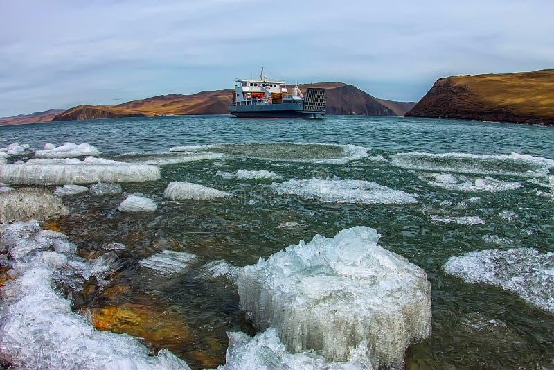 Spring melting ice of Lake Baikal, ferry crossing Olkhon gate royalty free stock photos
