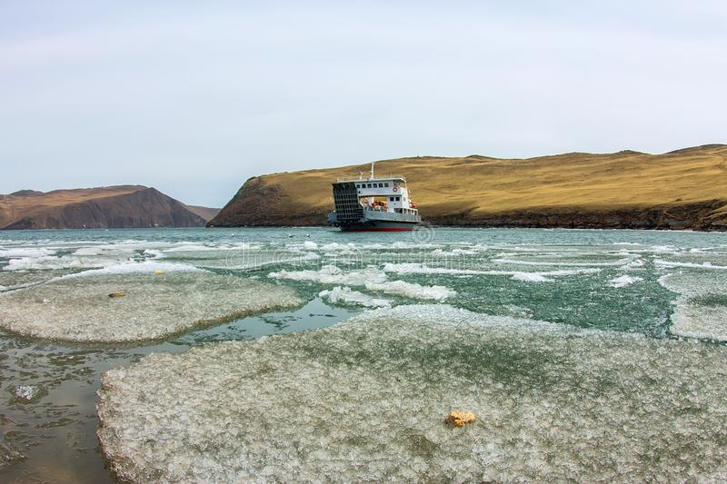 Spring melting ice of Lake Baikal, ferry crossing Olkhon gate royalty free stock photography