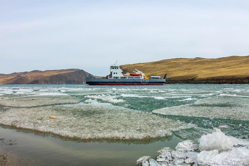 Spring melting ice of Lake Baikal, ferry crossing Olkhon gate stock photography