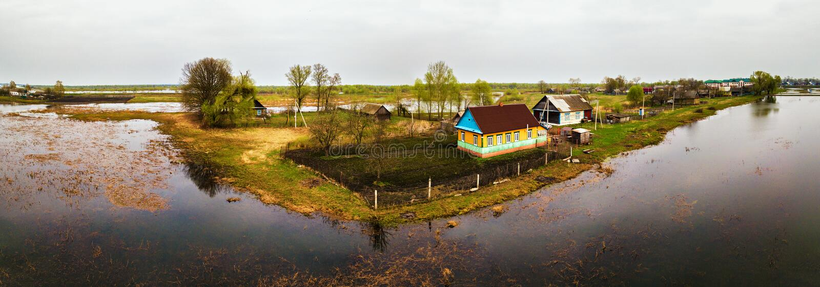 Spring melting river flood aerial panorama. Overflow water at sp stock images