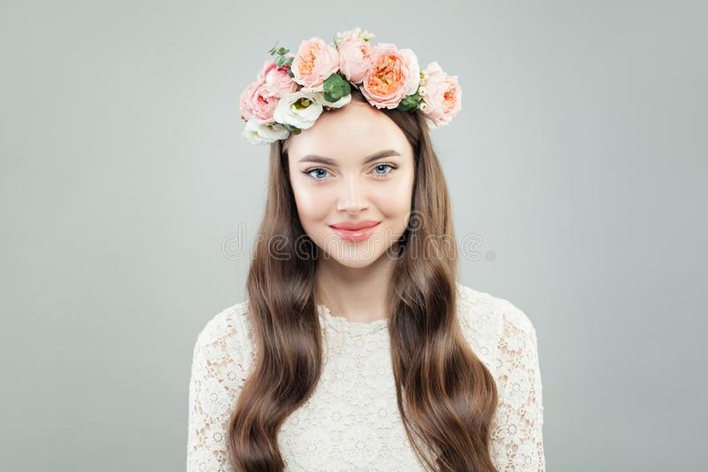 Spring Model Woman with Shiny Curly Hair, Natural Makeup and Tender Flowers stock photos