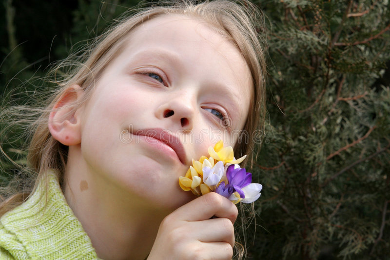 Spring mood. Young, dreaming girl with a bunch of crocuses stock images