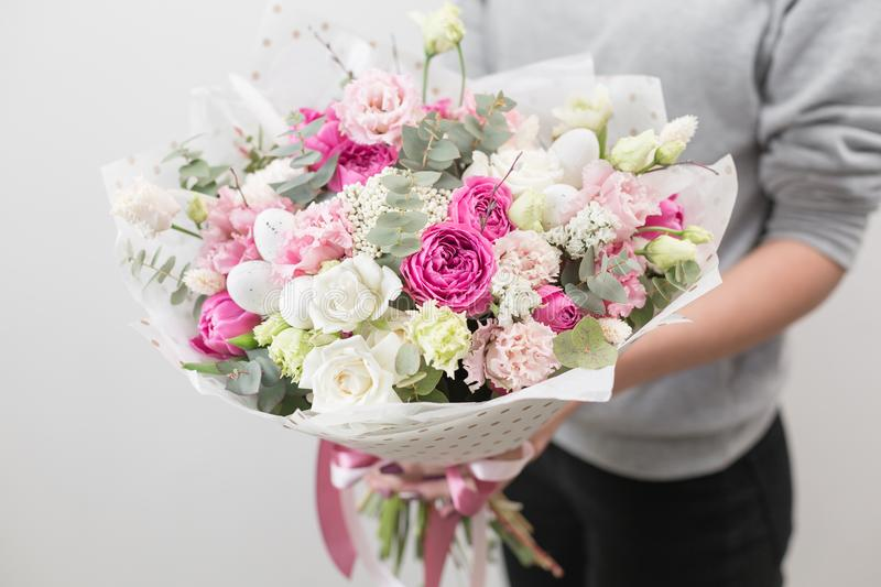 Spring mood. beautiful luxury bouquet of mixed flowers in woman hand. the work of the florist at a flower shop. Horizontal photo. Spring mood. beautiful luxury royalty free stock images