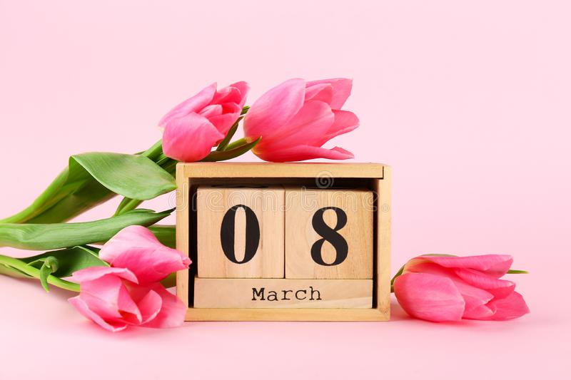 Spring mood concept. Pink flowers arrangement with a lot of copy space for text royalty free stock images