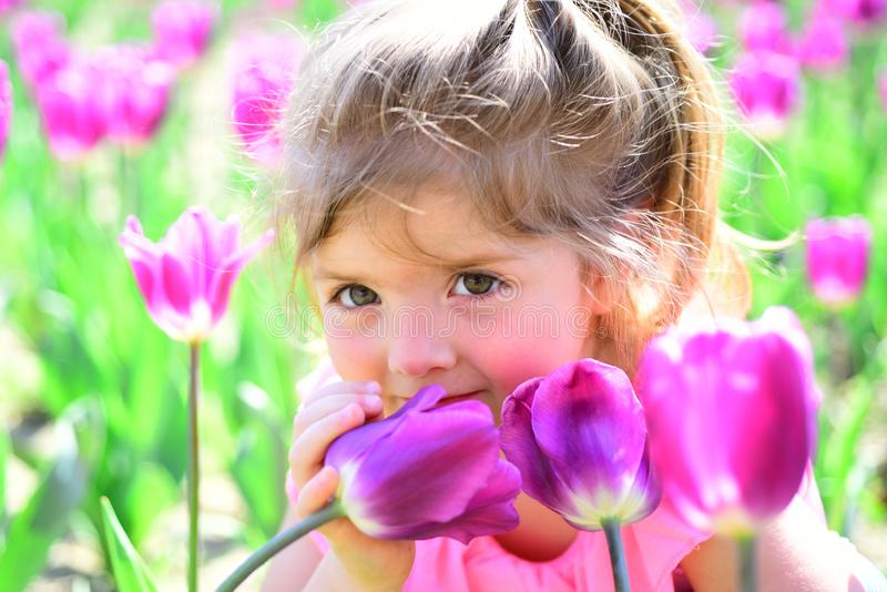 Spring mood. face and skincare. allergy to flowers. Springtime tulips. weather forecast. Summer girl fashion. Happy. Childhood. Little girl in sunny spring stock photography