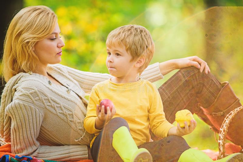 Spring mood. Happy family day. Sunny weather. Healthy food. Family picnic. Mothers day. Happy son with mother relax in stock images