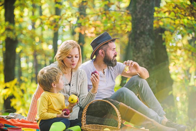 Spring mood. Happy family day. Sunny weather. Healthy food. Mother, cowboy father love their little boy child. Family stock image