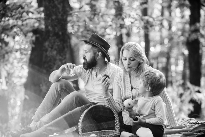 Spring mood. Happy family day. Sunny weather. Healthy food. Mother, cowboy father love their little boy child. Family royalty free stock images