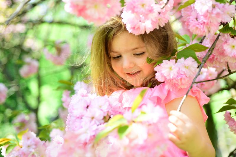 Spring in my head. Little girl in sunny spring. Summer girl fashion. Happy childhood. Springtime. weather forecast. face. And skincare. allergy to flowers stock image