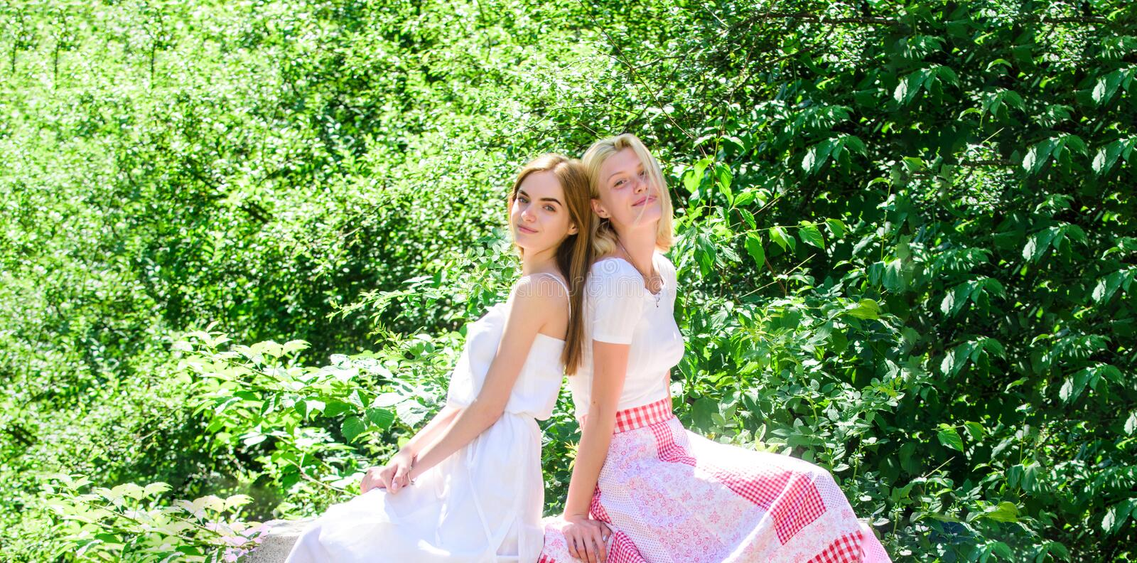 Spring nature lovers. natural beauty. summer fashion. beautiful women in green park. sexy girls relax outdoor. Sisterhood vacation. freshness of healthy skin royalty free stock photos