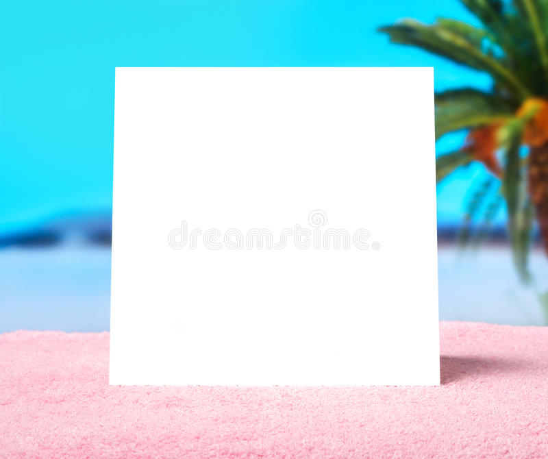 Spring offer or summer sale template background. White blank square card with free copy space on a towel on beach. stock photo