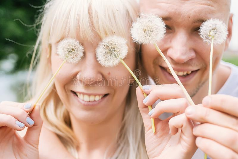 Spring outdoor portrait of young happy couple. Closeup photo stock photography
