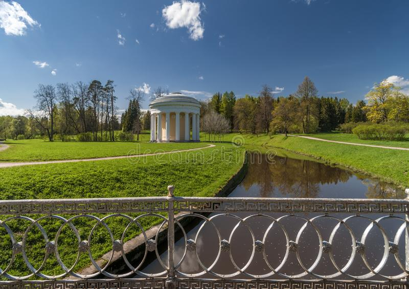 Spring park with classical building stock photo