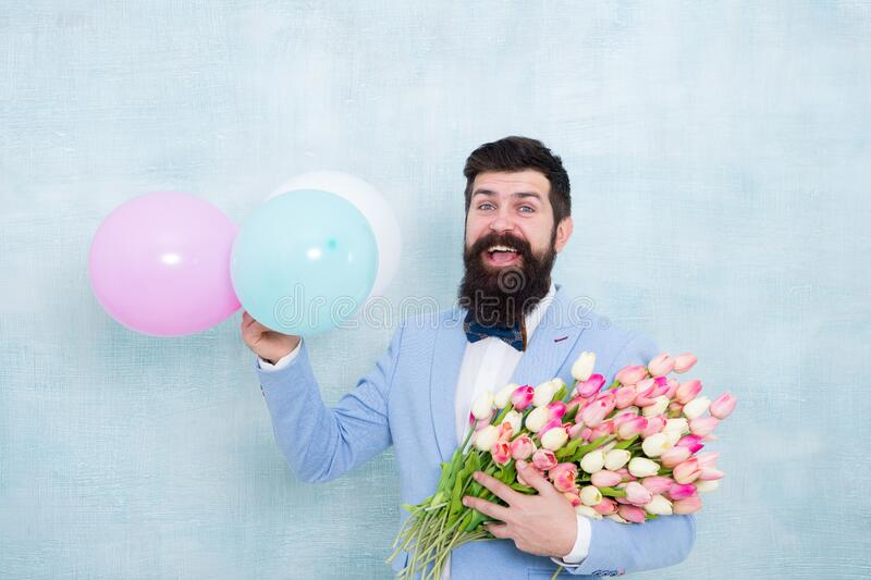 Spring party. Surprise party romantic proposal ideas. Present for spouse. Guy with air balloons. Birthday party. Bearded royalty free stock photos
