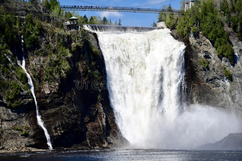 Montmorency Falls. This is a Spring picture of the iconic Montmorency a Falls located in Quebec City Quebec, Canada. The magnificent waterfall has two drops royalty free stock photo