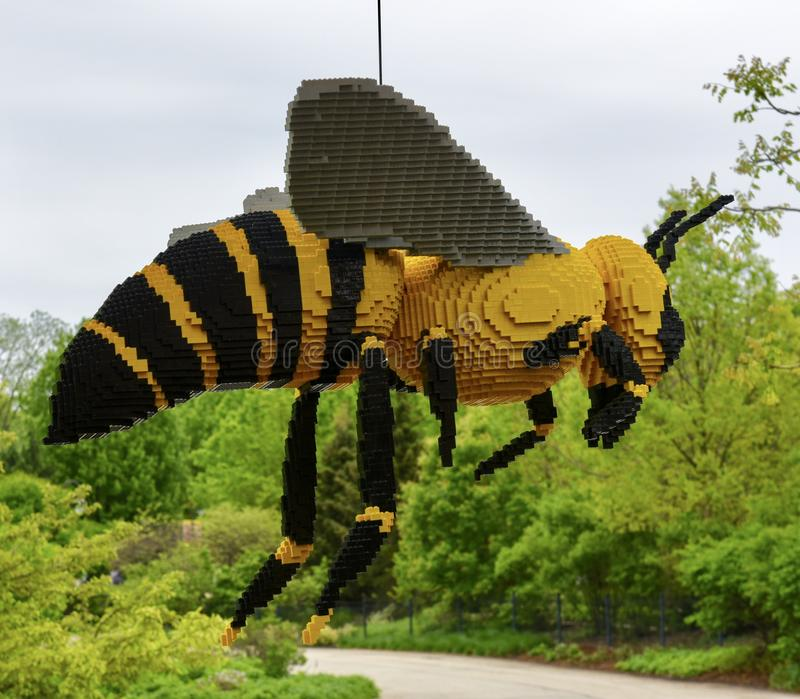 Bee. This is a Spring picture of a piece of public art titled: Bee; on exhibit at the Morton Arboretum in Lisle, Illinois in DuPage County.  This piece was royalty free stock images