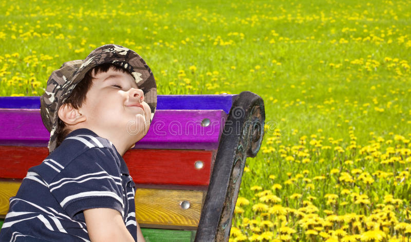 Spring pleasure. Little boy sits on a shop blindly royalty free stock photos