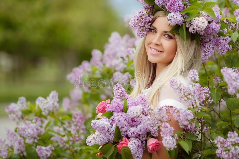 Spring portrait of a beautiful girl with lilac. stock photo