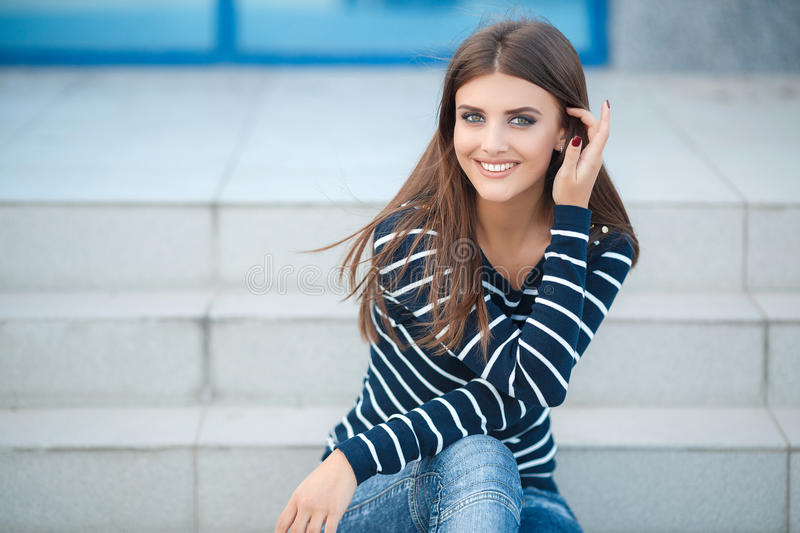 Spring portrait of a beautiful woman outdoors. Spring portrait of a happy brunette woman with long straight hair and gray-green eyes,light makeup,nice smile stock photos