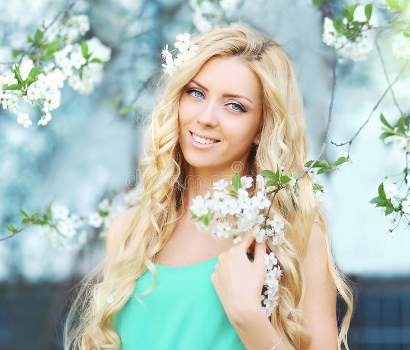Spring portrait of a beautiful young girl in flowering stock images