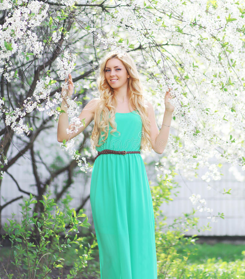 Spring portrait of a beautiful young smiling woman enjoying royalty free stock photography
