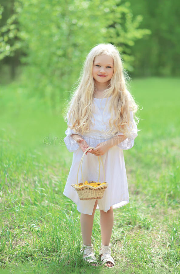 Spring portrait of cute little girl in white dress royalty free stock photos