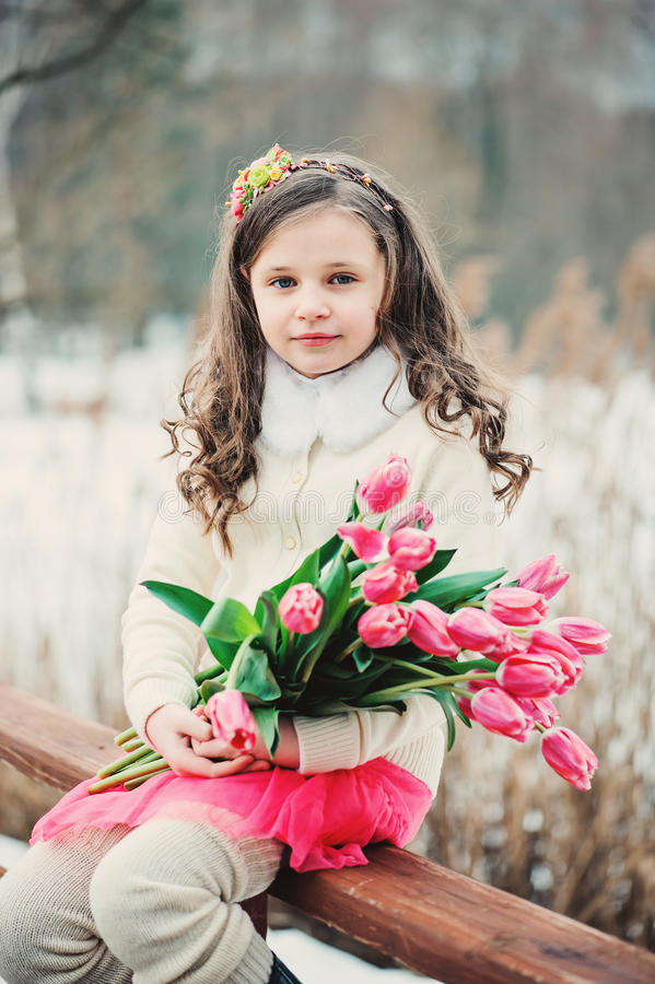 Free Spring Portrait Of Smiling Child Girl With Tulips Bouquet On The Walk Royalty Free Stock Photography - 51603997