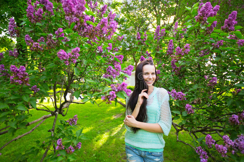 Spring portrait of pretty funny woman in lilac. stock image