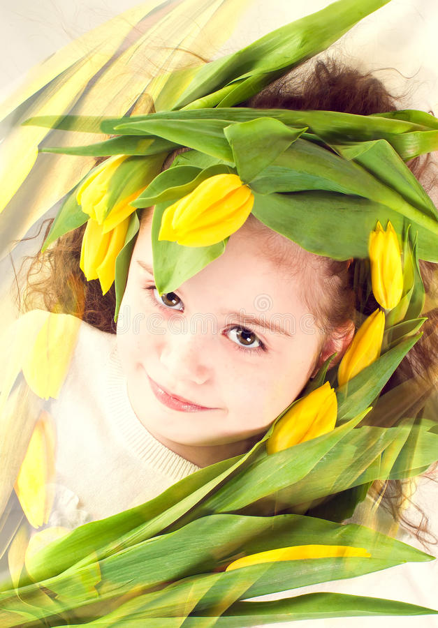 Download Young Girl With Flowers Tulips Royalty Free Stock Image - Image: 29728916