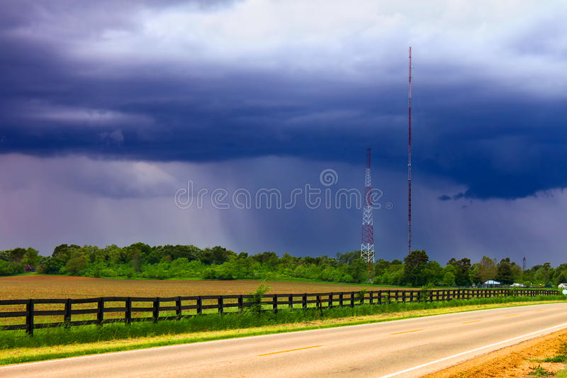 Spring Rain Landscape Illinois. Heavy spring rains sweep over agricultural fields outside the village of Cherry Valley Illinois royalty free stock photo