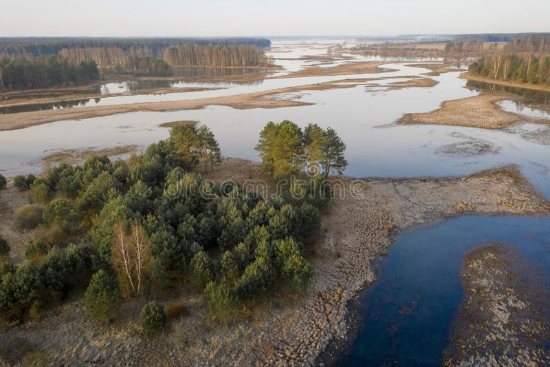 Spring river aerial view. Flood on floodplain at springtime stock images