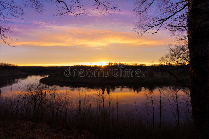 Spring. river. sunrise. sunset. Dawn over the river photographed in early spring.  stock photography