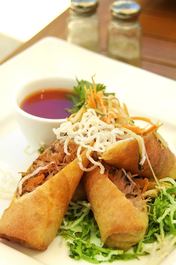 Spring roll served with chilli sauce royalty free stock image